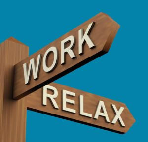 Work Or Relax Directions On A Wooden Signpost